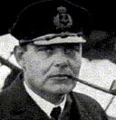 Old photograph of Riiser-Larsen, wearing an airforce cap.