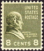 Postage stamp with the image of a bust of a balding man in profile and facing right