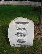 a roughly edged flat grey stone inscribed with the names of the women murdered, and dedicated by the engineering community at McMaster