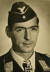 Head-and-shoulders portrait of a uniformed German air force pilot in his 30s wearing an Knight's Cross
