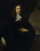 portrait of a man dressed all in black, looking left