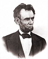 An older tired looking Lincoln with a beard.