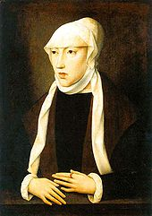 portrait of a thin woman in brown clothing and a tan head covering