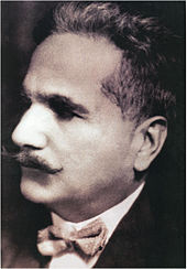 A black and white picture of a man with mustaches.