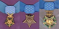 "Three medals, side by side, consisting of an inverted 5-pointed star hanging from a light blue ribbon with 13 white stars in the center. Medal on the left has a laurel wreath around the star and an eagle emblem above the star, middle medal has an anchor emblem attaching the medal to the ribbon, rightmost medal has a laurel wreath around the star and an emblem with wings, lightening bolts, and the word ""VALOR"" connecting the medal to the ribbon."