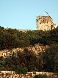 The Moorish Castle's Tower of Homage in Gibraltar flying the Union flag.