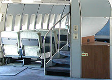 A spiral staircase on 747-100s and −200s that leads to the upper deck