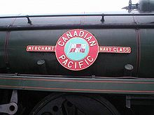 A Merchant Navy class enamelled metal nameplate mounted on the side of the locomotive boiler. The nameplate comprises a circle, containing a picture of the company flag of the shipping line, and two rectangles on either side containing the class name. In a larger circle bordering the central flag is the name of the shipping line.