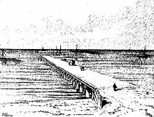 A pier stretching from land out over water