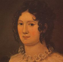 Portrait of a woman showing her neck and head. She has brown hair in ringlet curls and we can see the ruffle from the top of her dress. The painting is done in a palette of oranges and browns.