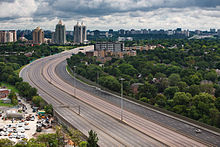 An empty freeway in the middle of a city.