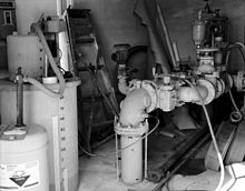 Large water pipes next to monitoring equipment.