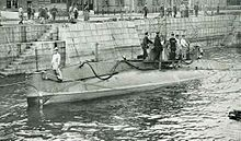 Submarine surfaced in a Japanese harbour.