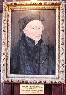 An elderly man in black robes and cap; the picture is in a decorated gold frame.