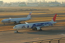 Two twin-engine airliners on parallel taxiways.