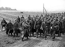 A photo of a crowd of marching Polish prisoners of war captured by the Red Army during the Soviet invasion of Poland