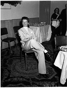A middle aged woman wearing a suit