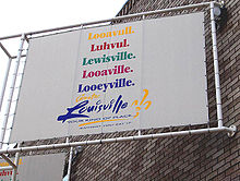 "A poster displaying five common phoenetic pronunications of ""Louisville"" - ""Looavull,"" ""Luhvul,"" ""Lewisville,"" ""Looaville,"" ""Looeyville."""