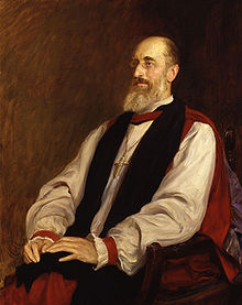 A painting of a gaunt and balding man, with greying hair and a long grey beard, sitting in a wooden chair. He wears a puffy white shirt, a black stole, and a long red robe; he also wears small round glasses, and around his neck is a large gold cross.