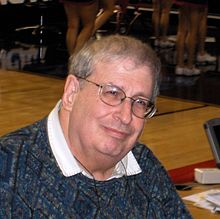 picture of Mel Greenberg attending a basketball game
