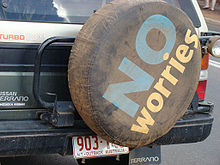 A tire cover on the back of an SUI displays the slogan.