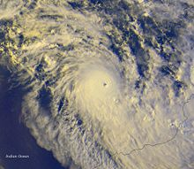 Satellite image of a powerful cyclone near the coast of Western Australia. The storm is relatively small but very mature, with a condensed area of deep thunderstorms and a well-defined, clear eye.