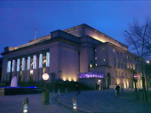 Sheffield City Hall, a Neo-classical design with a large portico and prominent pillars which were damaged when a bomb fell on the ajoining Barkers Pool during World War II. It is a grade II* listed building