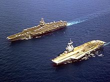Photograph of two aircraft carriers.