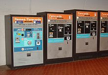 A row of fare-card machines, each with buttons, slots for money and farecards, and printed instructions.