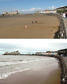 Two photographs showing the sea wall and buildings. The left had side is an expanse of sand in the top picture and water covered in the bottom picture.