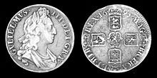 A silver coin picturing William III and his coat of arms