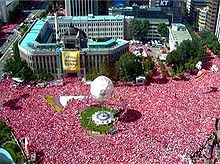 Sea of supporters in Seoul during the 2002 FIFA World Cup text