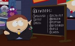 """A male, fourth-grade animated character stands by a chalkboard on which he has written """"Keywords: Integrated, Leftist, Liberal"""" in the left-hand column, and """"Socialist, Modern, Utopian, Reformed, Farce, School"""" in the right-hand column, and has circled the first letter of each word to form the acronym """"KILL SMURFS"""""""