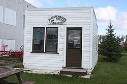 "Small wooden shack, painted white, with sign ""J.G. Diefenbaker Law Office 1919–1925"