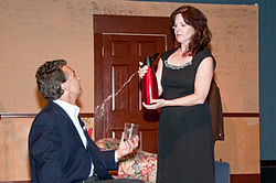 "caption=Jacqueline (Tina Segovia) splashes Bernard (Joe Kelly) with soda in the 2009 Potomac Theatre Company production of ""Don't Dress For Dinner"""
