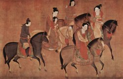 A landscape oriented painting depicting five women in brightly colored dress riding on horses, speaking to one another. Most of the robes are red or include red in them.