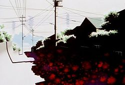 A suburban scene on a sunny day, showing houses and telegraph poles, but the shadows contain unnatural red splotches.