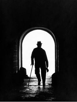Contre-jour emphasizes the outline of the man and the tunnel entrance