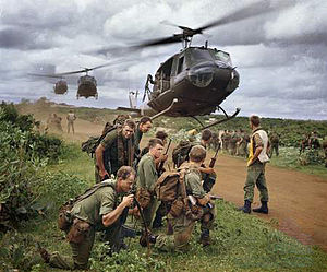 Australian soldiers from 7 RAR waiting to be picked up by US Army helicopters following a cordon and search operation near Phước Hải in 1967