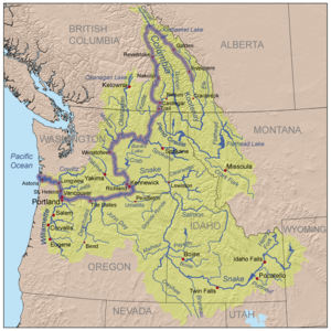 Three-color map of the Columbia River watershed. The watershed is shaped roughly like a funnel with its wide end to the east and its narrow end along the border between Washington and Oregon as it nears the Pacific Ocean. The watershed extends into the western U.S. states of Washington, Oregon, Idaho, Nevada, Utah, Wyoming, and Montana, and the western Canadian province of British Columbia as far east as its border with Alberta. The river itself makes a hairpin turn from north-west to south in British Columbia and another sharp turn from south to west as it nears Oregon.