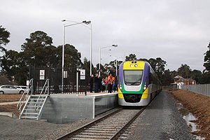 VLocity train stopped at Creswick,the original station building and platform in the background