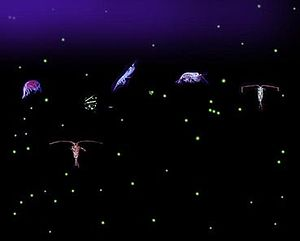 Six relatively large, variously-shaped organisms with dozens of small light-colored dots all against a dark background. Some of the organisms have antennae that are longer than their bodies.