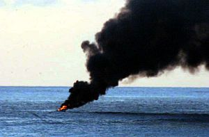 Pirate vessel burning (Center).